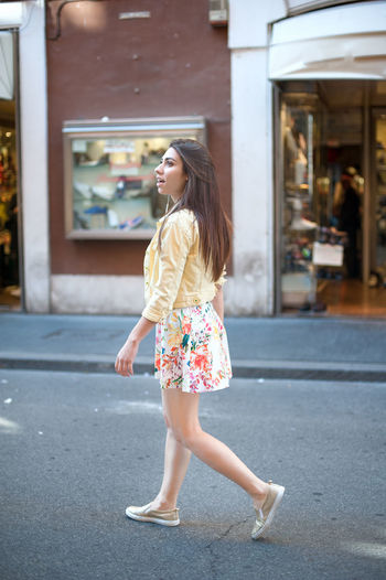 Young woman walking for shopping in city street Casual Clothing City Life Cute Day Focus On Foreground Full Length Leisure Activity Lifestyles Outdoors Portrait Shopping Street Urban Woman
