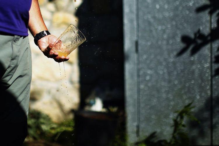 Man holding a splashing glass of juice