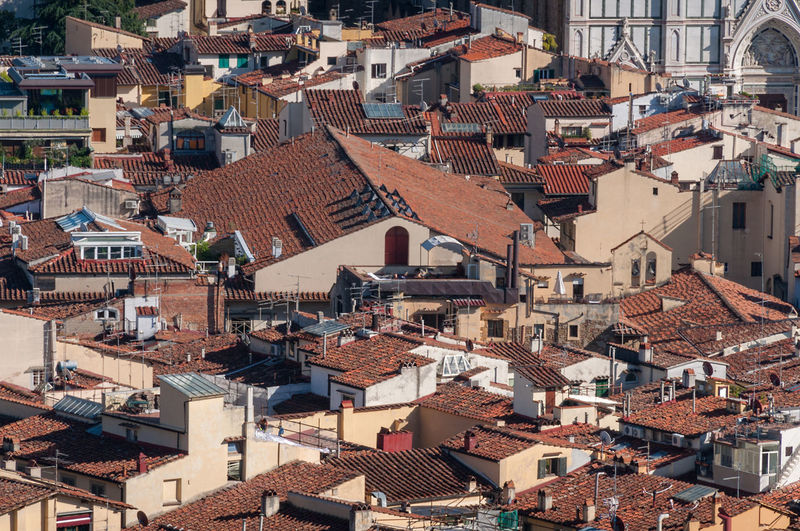 Birds eye view of red-tiled rooftops of florence medieval historic cenrte in italy