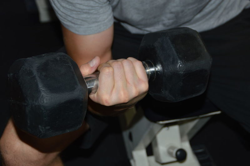 Midsection Of Man Exercising In Gym