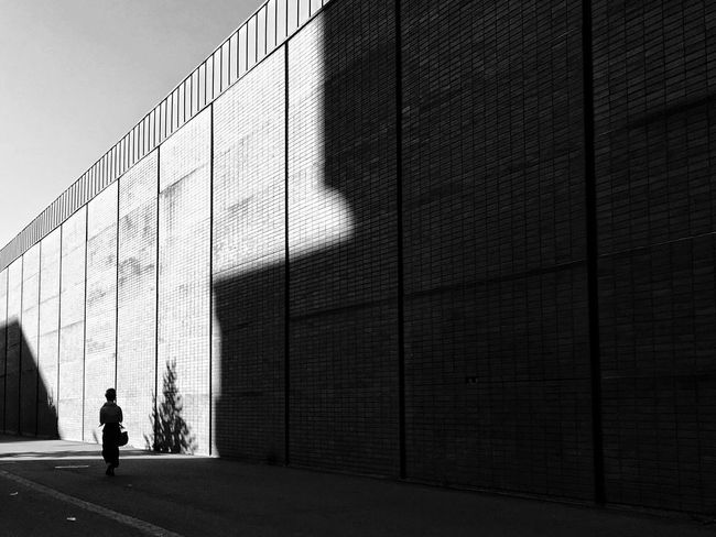 Shadow and darkness Architecture One Person Building Exterior One Man Only People Streetphotography Streetphoto_bw Shadows & Lights Shadowplay