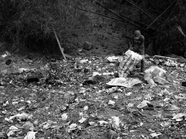 Collecting the excess..... Smartphone Photography Mobile Photography Eyeem Philippines Taking Photos Monochrome Adult Garbage Dump Garbage Collection Garbage Man RealityCheck Huawei Photography Leica Huawei Huawei Mate 9 Shotwithhuaweimate9 DualCamera Sad But True  Kokopaps