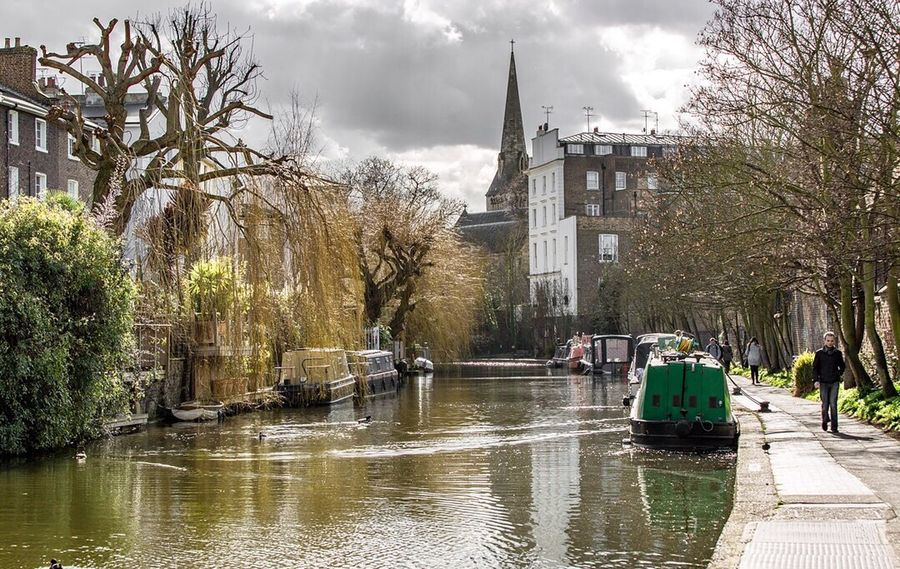 Taking in the quiet away from the hustle and bustle. Narrowboat Canal Towpath Silence Stillness Away From The Hustle Church Steeple Camden London London Lifestyle