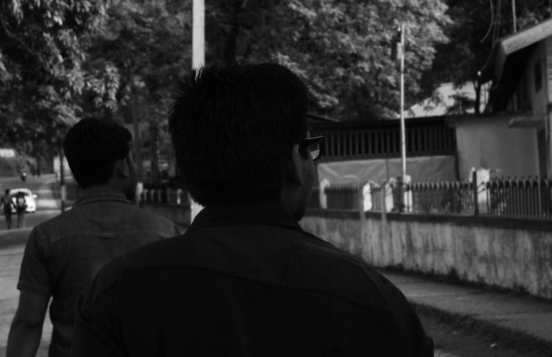 Unknowingly... Balck And White Candid Candid Photography Candid Portraits City Life From Back In Daylight Monochrome Monochrome_life On The Road Outdoors Rear View