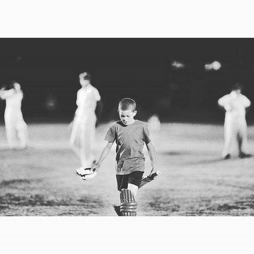 BLOEMFONTEIN, FREE STATE, SOUTH AFRICA. - Dino Koetzee walks off the field after losing his wicket for only 3 runs. Dino and his teammates from Koot Niemann Primary School took on Willem Postma Primary School in their first night time T20 game. Cricket Kids Sport T20 School Schoolsports Kidsplayingsport Photojournalist Mycameraandi Canon600D Burndre Lovephotography  Eye4photography  Havingfun Playtime