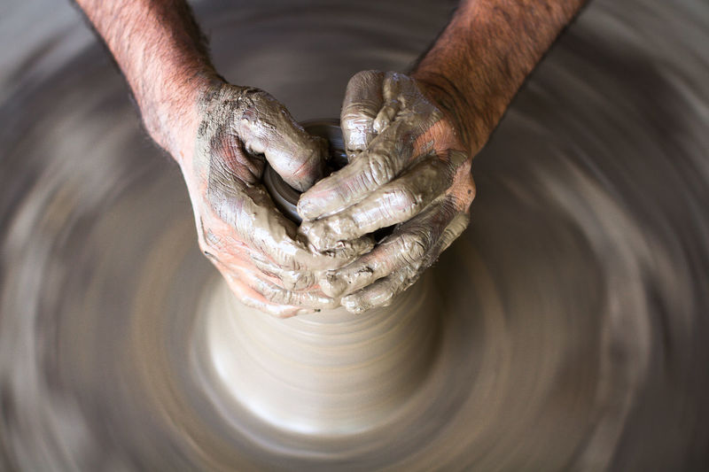 Cropped Hands Of Potter Molding Shape