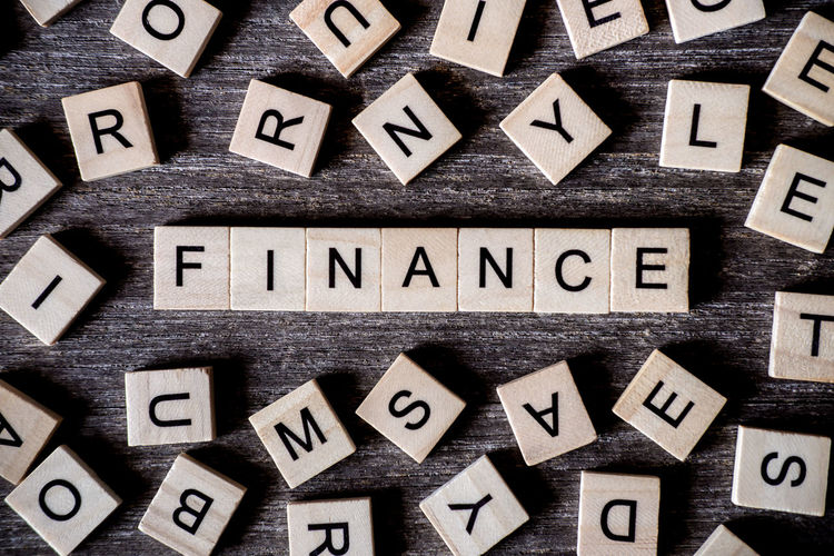 Directly Above Shot Of Finance Text On Table