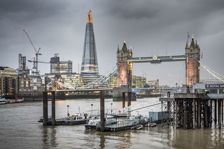 The Shard Building And Tower Bridge Against Cloudy Sky At Dusk