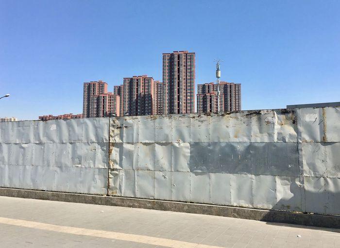 View of buildings against blue sky