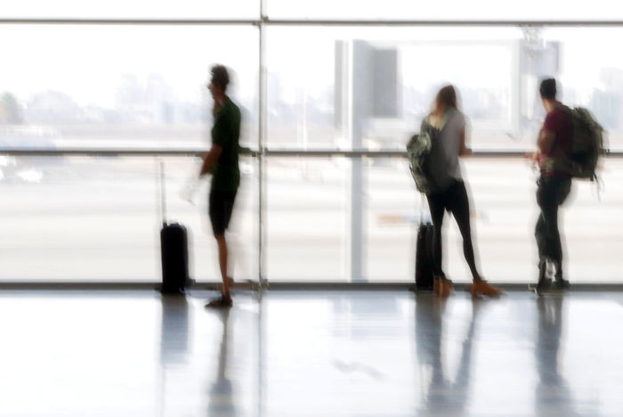 Against The Light Airport Blur Blurred Motion City Life Day Focus On Foreground Full Length Glass - Material Indoors  Israel Leisure Activity Lifestyles Person Standing Sylouette Telaviv Transparent Transportation Travel Window