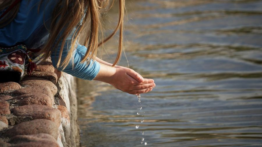 Close-up of woman holding water