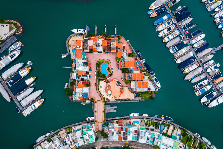 Aerial view of houses and dock Building Colourful Marina Road Trees Ship Water Holiday Landscape Town City Architecture Cityscape High Angle View Urban Aerial View Drone  Green Yacht Yachting Marine Seascape Vacations Power In Nature Wave Sports Photography Boat Sports Equipment Sea Hosue