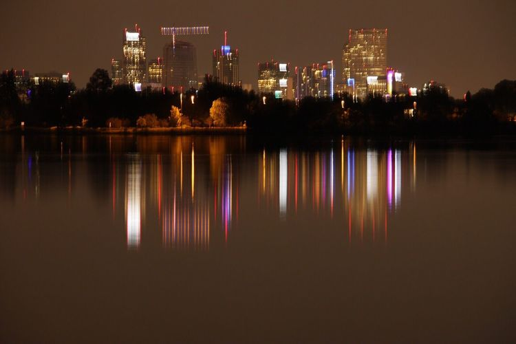 Illuminated Architecture Night Building Exterior Reflection Built Structure City No People Skyscraper Outdoors Tree Sky Cityscape Modern Water City Lights At Night Denver Skyline Architecture Clear Sky Dp Design Tranquility Reflection City Horizon Over Water