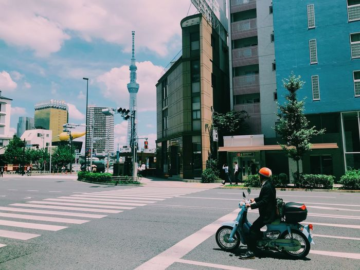 Tokyo street view Motorcycle Streetphotography Tokyo Street Photography Tokyo Building Exterior City Architecture Built Structure Transportation Street Mode Of Transportation City Life Building Road Sky City Street Land Vehicle Cloud - Sky