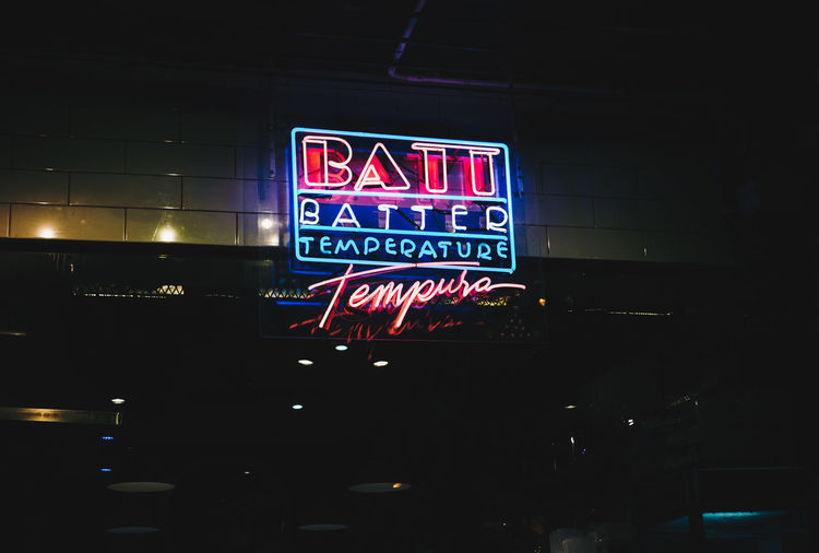 Illuminated Communication Sign Text Western Script Night Neon No People Architecture Information Built Structure Information Sign Building Exterior Lighting Equipment City Low Angle View Capital Letter Commercial Sign Guidance Advertisement Nightlife