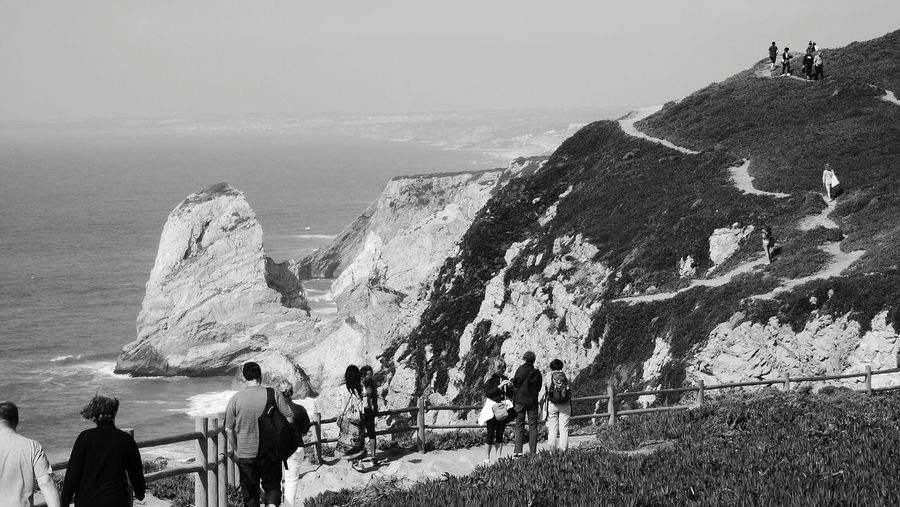 People At Observation Point By Sea
