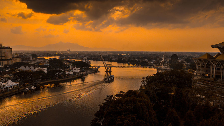 Aerial Shot of Sarawak River at sunset Borneo Cityscape Riverside Aerial View Architecture City Cloud - Sky Cruise Dji Evening Sky High Angle View Kuching, Sarawak Malaysia No People Orange Color Outdoors River Scenics - Nature Sky Sundown Sunset This Week On Eyeem Water