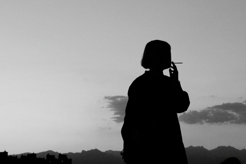 Photography Themes Standing Women Silhouette Photographing Wireless Technology Bad Habit Three Quarter Length Sky