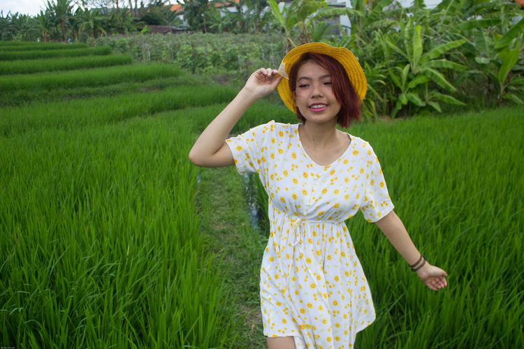 Smiling Woman Standing On Field
