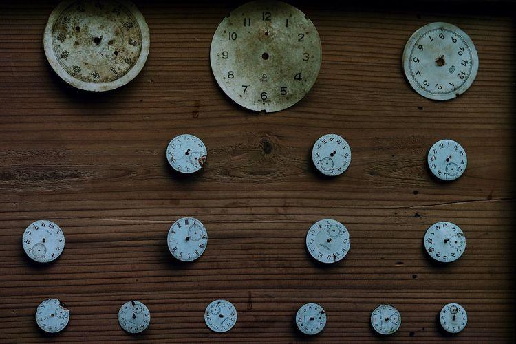 Clocks On Wooden Wall