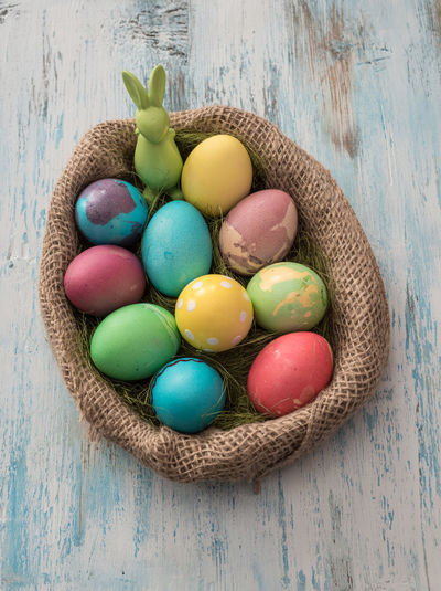 High Angle View Of Easter Eggs In Sack On Table