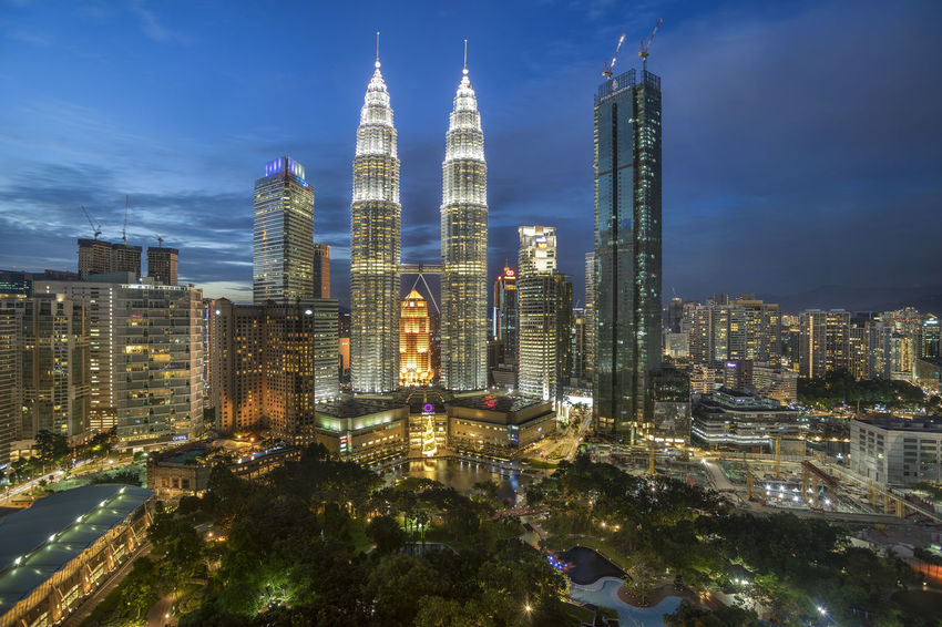 Beautiful Blue Hour in cityscape Blue Hour Kuala Lumpur Tree Architecture Blue Hour Cityscape Building Exterior Built Structure City Cityscape High Rise Building Illuminated Malaysia Modern Night No People Outdoors Sky Skyscraper Travel Destinations
