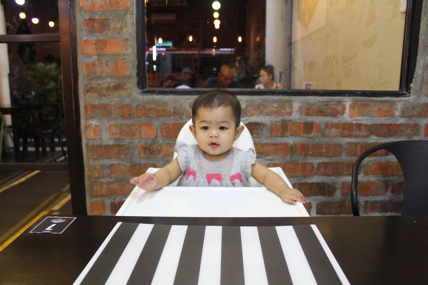 Cute little infant waiting for food in a restaurant Eating Infant Photography Meal Waiting Childhood Cute Cute Girl Day Eat Food Front View Girl Infant Little Girl One Person Outdoors People Real People