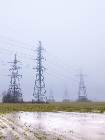 Cable Cloud - Sky Connection Day Desaturated Electricity  Electricity Pylon Field Foggy Fuel And Power Generation High Voltage Icy Iron - Metal Landscape Nature No People Outdoors Power Line  Power Supply Scenics Sky Technology Transmission Transmission Line Water And Ice
