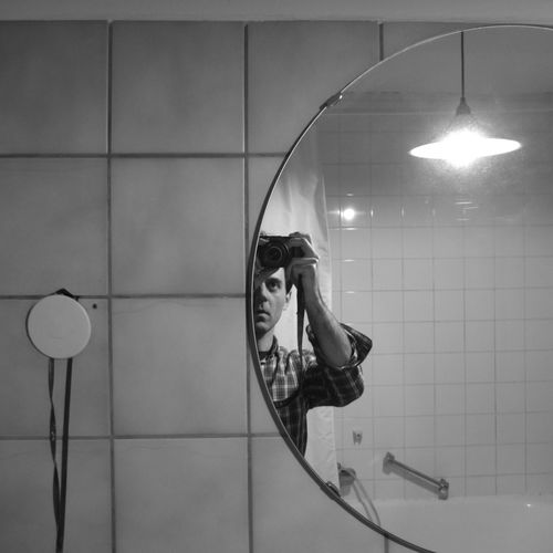 Self portrait in a bathroom Tiles Tiles Textures Mirror Mirrorselfie Bathtub Lamp Shower Curtain Self Portrait Selfie✌ Blackandwhite Bathroom Man One Person Camera Photographic Equipment Hanging Illuminated Shower