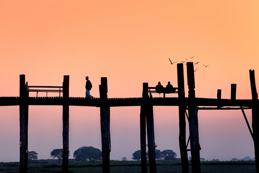 U-bein bridge at dawn in Amarapura, Myanmar. Atmosphere Beauty In Nature Bridge Dawn Idyllic Landmark Morning Myanmar Nature Orange Color Outdoors Pastel Peaceful Scenics Silhouette Silhouette Sky Soft Sunrise Sunset Tranquil Scene Tranquility Travel Unrecognizable Person Wooden Bridge