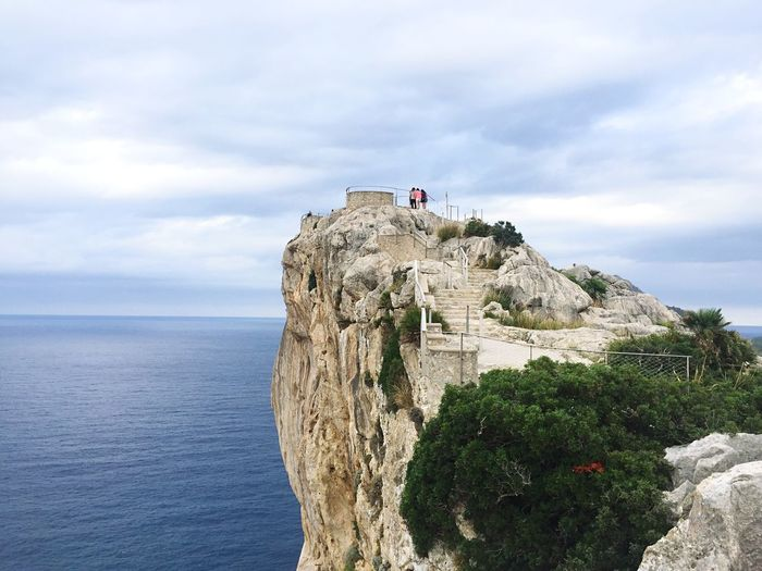 Scenic View Of Cap De Formentor Against Cloudy Sky