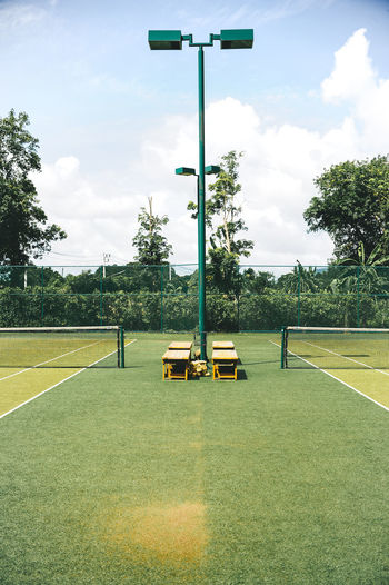 Paint The Town Yellow Beauty In Nature Cloud - Sky Day Field Goal Post Grass Green Color Growth Men Nature Outdoors People Playing Field Real People Sky Soccer Soccer Field Sport Standing Tree