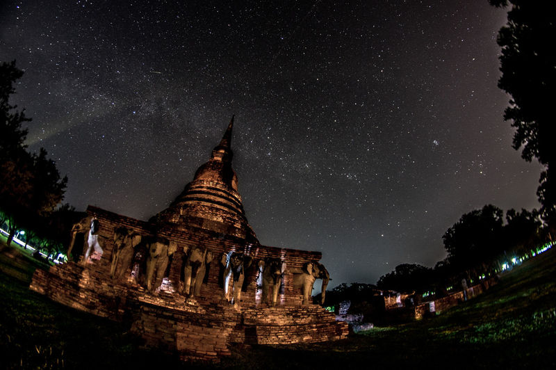 Ancient temples in sukhothai Buddha Buddhist Temple Thailand Architecture Built Structure Night Religion Sky Star - Space Building Exterior Space Place Of Worship Spirituality Building Belief History Astronomy Nature No People Travel Destinations The Past Ancient Civilization