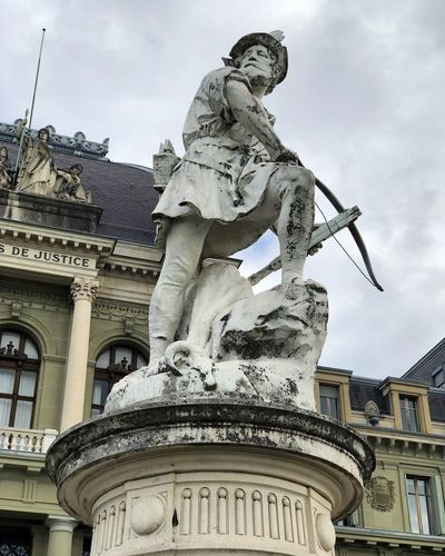 Guillaume Tell Statue Sculpture Architecture Human Representation Sky Low Angle View Cloud - Sky