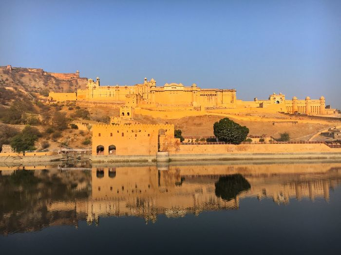 Amber Fort Reflecting In Lake Maota Against Clear Sky