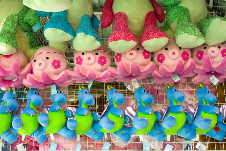 Multi colored toys for sale at market stall
