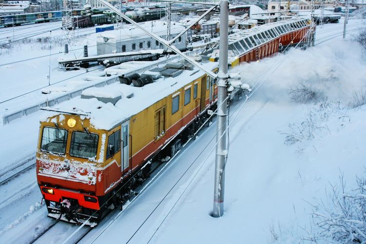 Cleaning the road. Winter Snow Train Railroad Railway Industrial Murmansk Russia