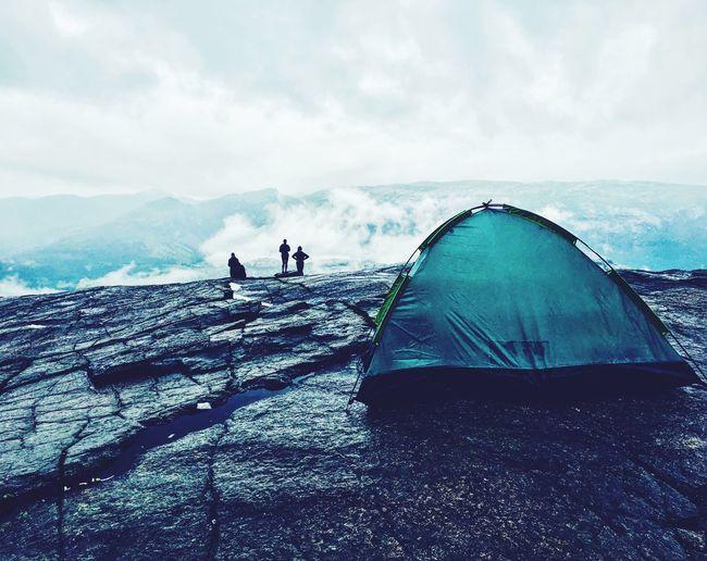 Close-up of tent on mountain against sky