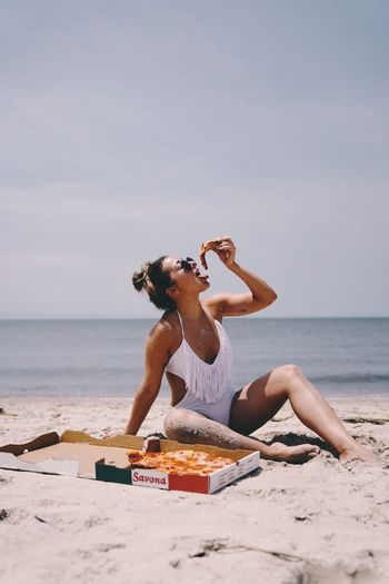 EyeEm Selects Sea Beach Food And Drink One Person Leisure Activity Sky Vacations Outdoors Young Adult Summer Sitting Food Full Length Day Nature Water Beauty In Nature Young Women Freshness The Week On EyeEm