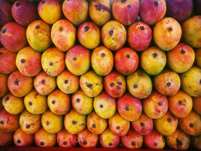 Full frame shot of stacked mangoes