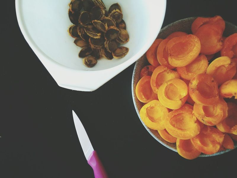 Apricots Healthy Eating Fruit Food And Drink Food High Angle View Table Freshness Indoors  Directly Above Close-up Sweet Food No People Black Background Day Kernels Preparing Food Cutting Knife Cutting Seasonal Seasonal Fruit