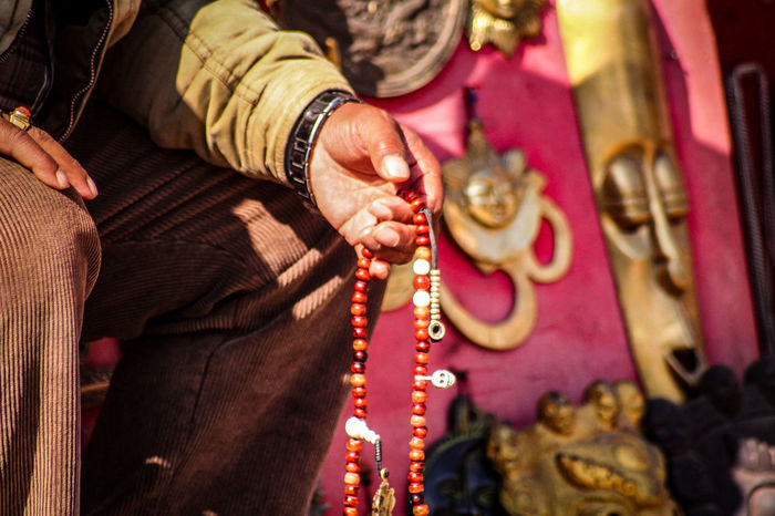 Praying Beads Adults Only Cultures Celebration One Person Human Hand Holding Prayer Beads Close-up Gold Colored Midsection Bangle People Gold Calm Zen Street Photography Kathmandu, Nepal Thamel Street Traditional Clothing Religion Travel Photography Travel EyeEm Best Shots Life The Street Photographer - 2017 EyeEm Awards