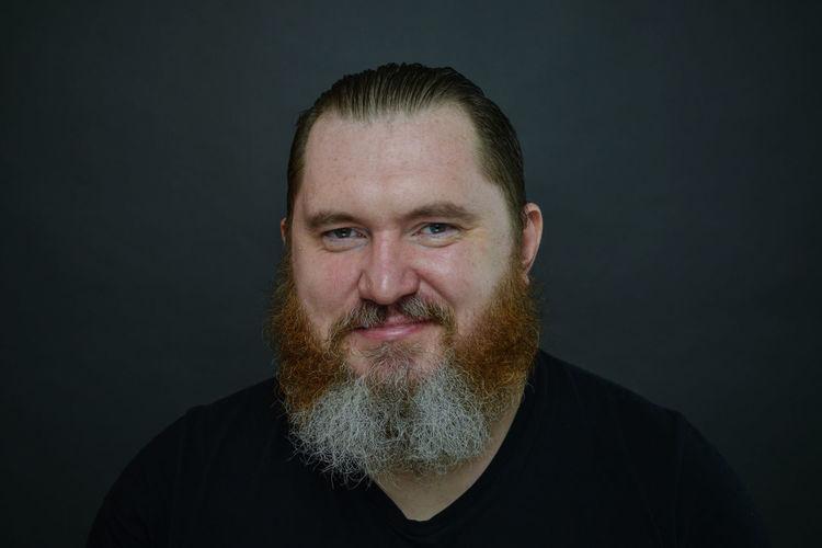 Portrait of man against black background