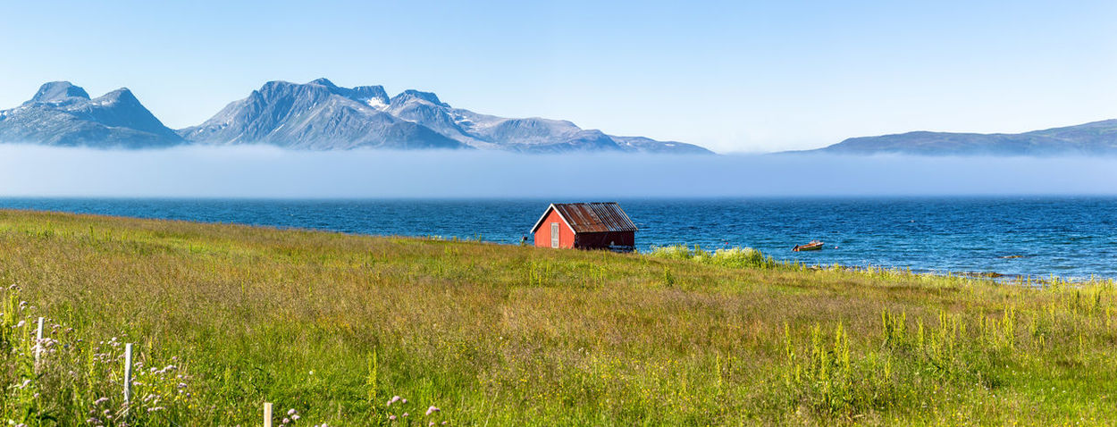 Beauty In Nature Blue Calm Cottage The Great Outdoors - 2017 EyeEm Awards Fog Grass Horizon Over Water Idyllic Landscape Majestic Mountain Mountain Range Nature Nature Northern Norway Norway Outdoors Remote Scenics Sea Sky Tranquil Scene Tranquility Water