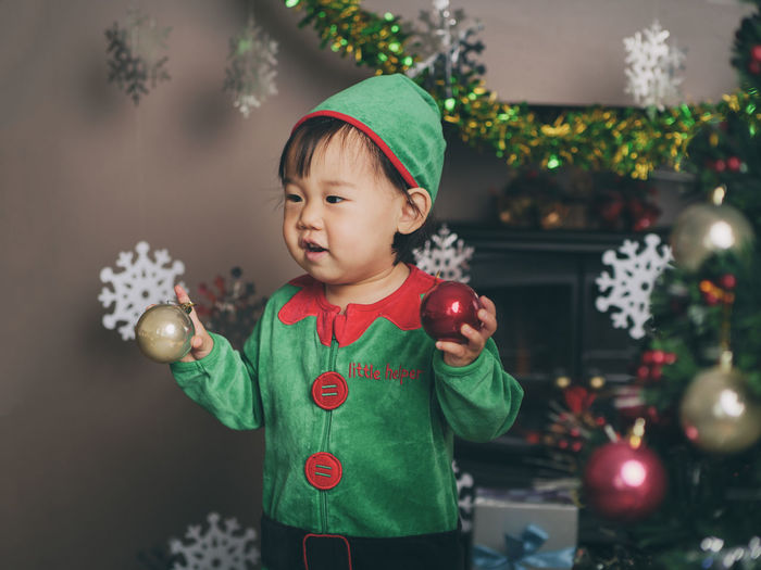 Elf Asian Baby Girl Celebration Childhood Christmas Christmas Decoration Cute Day Green Color Indoors  Looking At Camera One Person People Portrait Real People Standing Tree Waist Up