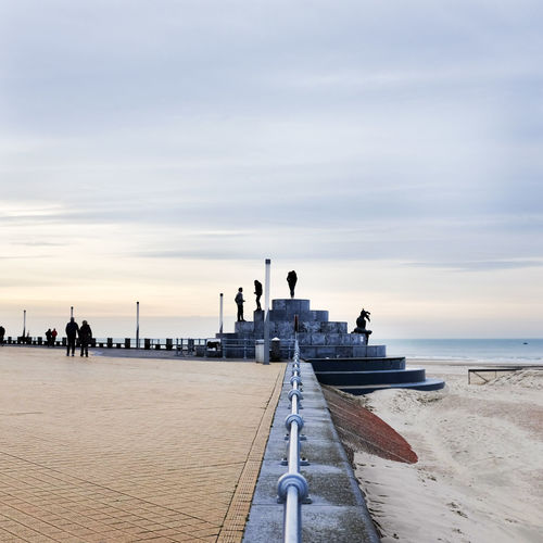 Oostende Belgium 2015 Calm Cloud Composition Distant Horizon Over Water Jetty Journey Long Mid Distance Ocean Outdoors Perspective Pier Railing Rippled Sea Sky Sunset The Way Forward Vacations Water Weekend Activities