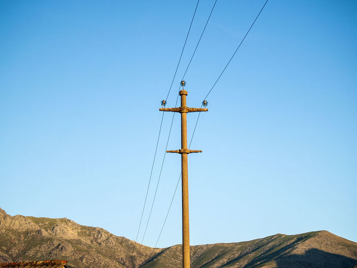 Electricity power on countryside Ancient Blue Cable Clear Sky Day Electric Electrical Tower Electricity  Electricity Pylon Environment Landscape Landscapes Low Angle View Nature Nature No People Old Old Town Outdoors Rural Sky Tower Wire