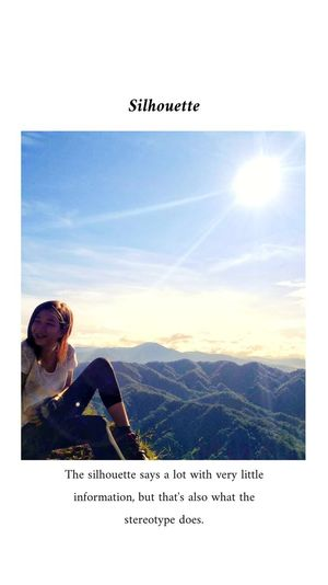 Woman with text on mountain against sky