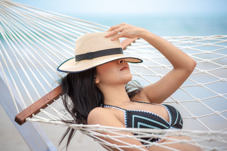 One Person Hat Real People Clothing Young Women Young Adult Leisure Activity Lifestyles Women Beautiful Woman Portrait Day Beauty Adult Headshot Sun Hat Smiling Water Hair Fashion Swimming Pool Outdoors Hairstyle