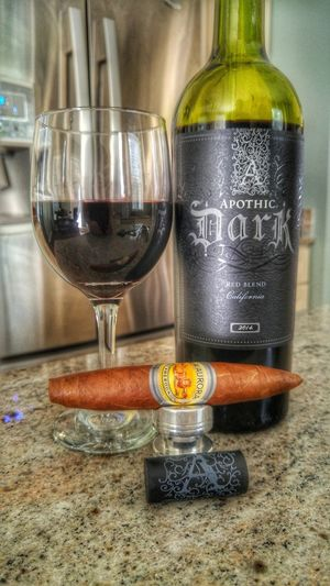 Sunday down time. Relaxing Enjoying Life Cellphone Photography Photoeffects Cigarlovers Cigarphotography Cigarlifestyle Cigarart Red Wine Downtime